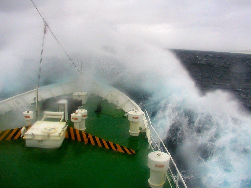 ship-crashing-through-wave-1523276
